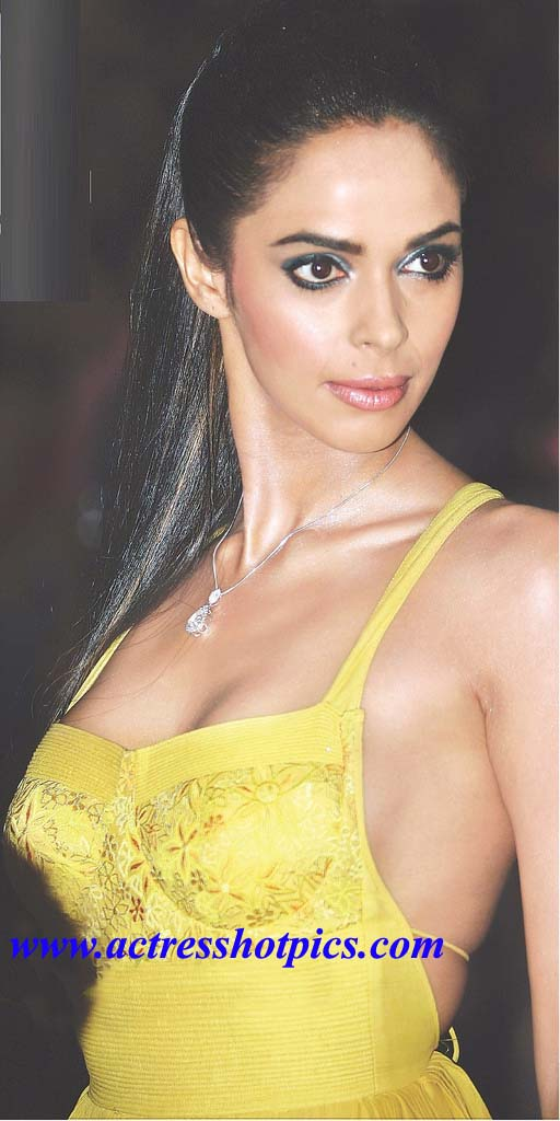 http://ravinderpics.files.wordpress.com/2010/10/mallika-sherawat-exposing-heavy-boobs-wallpapers-in-yellow-dress.jpg